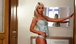 Hot light-haired magnificence is stimulating her wet crack eye with a huge big dildo