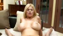 Hot unclothes blonde is riding a bigger sweetmeat and keeps immersing it