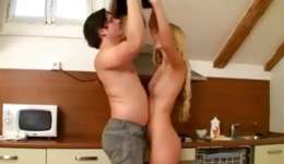 Hot blonde is acting sexually weird while sucking a boner in the kitchen